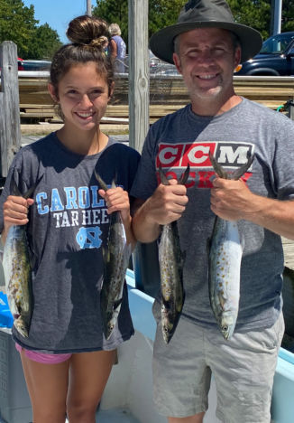 Dad and daughter with fish
