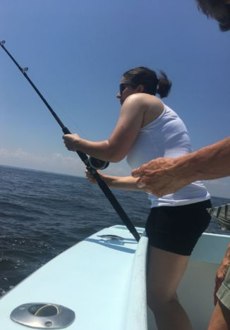 young lady with trolling rod